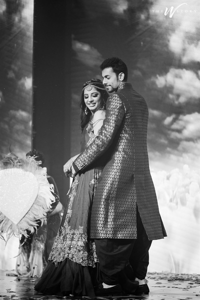 black and white candid capture of the bride and groom dancing at the sangeet