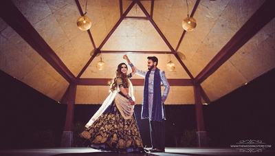 Happy couple in a sabyasachi lehenga and sabyasachi sherwani