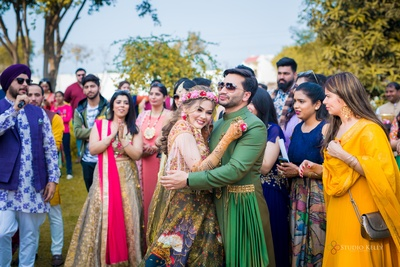 the couple got captured sharing a happy moment at their mehendi
