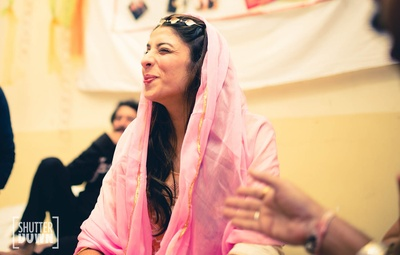 Candid picture of the bride at her chuda ceremony