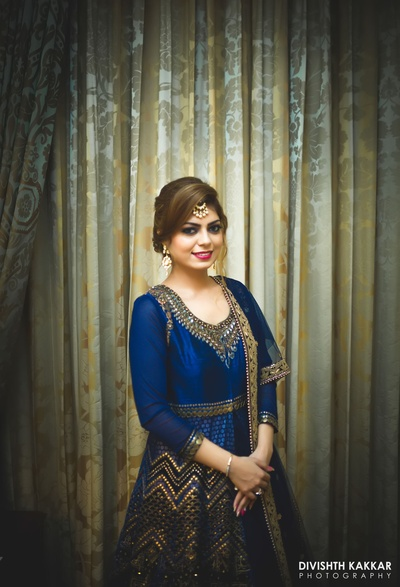 Gurpreet dressed up in a royal blue and copper color sequence work anarkali for the engagement ceremony.