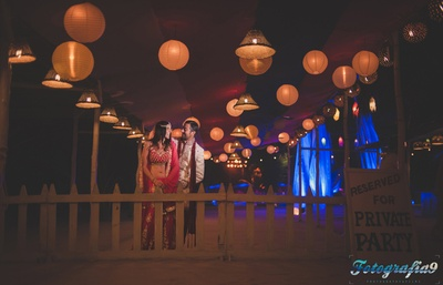 Wedding venue decorated with globe lanters and jute upside down lanterns