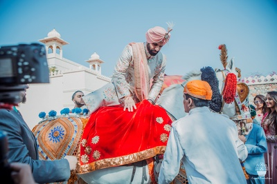 Bride getting on a Ghodi for the Baraat
