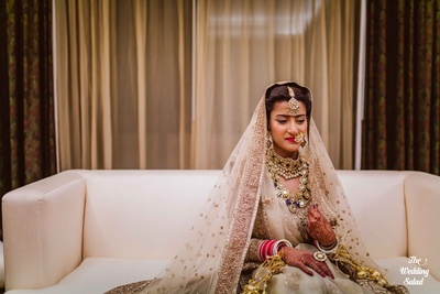 Decked and dressed in precious jewels and a champagne gold Sabyasachi lehenga