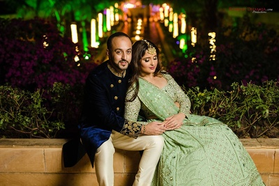 Bride and groom pose together during their engagement and sangeet function at Della Resorts, Lonavala