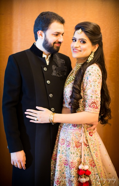 The groom wore a bandhgala jacket, while the bride wore a heavily embroidered cream lehenga.