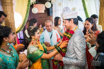 Varmala exchange between the bride and groom during the wedding ceremony