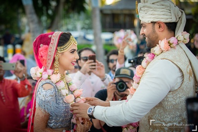 The bride and groom exchanging garlands during the jaimala ceremony.