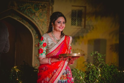Meera Mahadevia, ace bag designer dressed in pretty floral's for her daughter's wedding at the Neemrana Palace Fort
