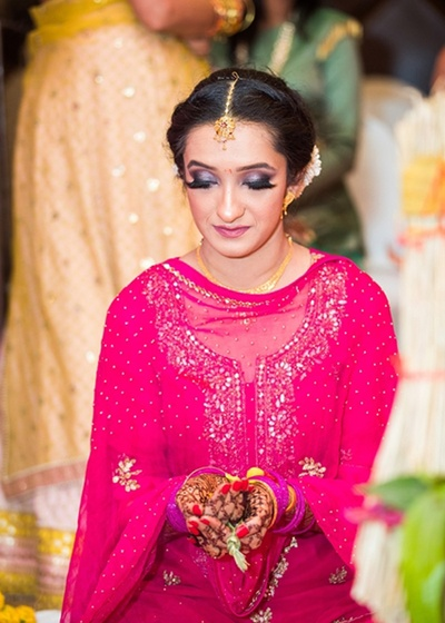 The bride in magenta gharara for her pheras
