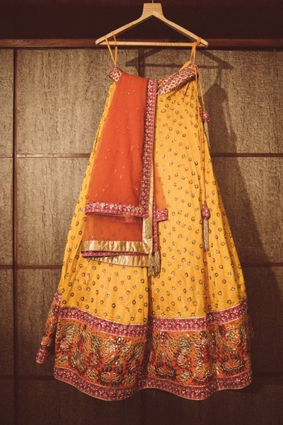Yellow lehenga embellished with zari buttis and embroidery