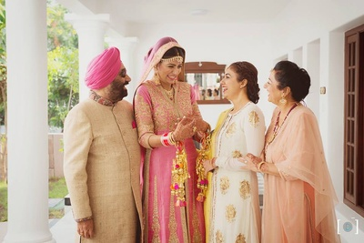 Bride Bismin with her family on the wedding day.