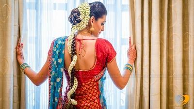 Bridal juda of spiral Mogra flowers and hair ornaments