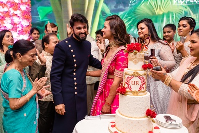 a candid capture of the couple during the cake cutting