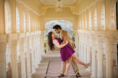 Purple shift dress styled with nude shade heels for her, and tan suit for him, for the pre weddimg photo shoot