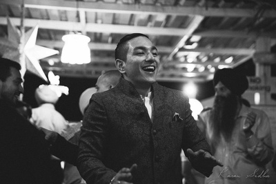 Groom dressed in a woven banhgala jacket styled with a pocket square