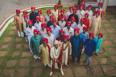 the groom and his baraat waiting to enter the venue