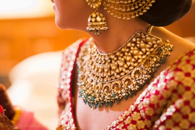 Regal bridal necklace set studded with polki and pearl ganthan
