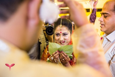 Bride entering the wedding venue holding betel leaves