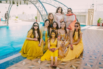 bride with bridesmaids for the haldi ceremony shoot