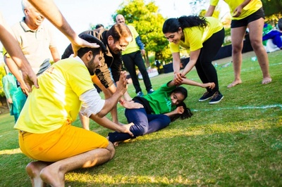 A kabbadi match organized between Team Bride and Team Groom with respective yellow and green jerseys