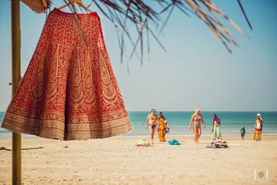 The gorgeous lehenga from Meena Bazaar framed against the blue ocean