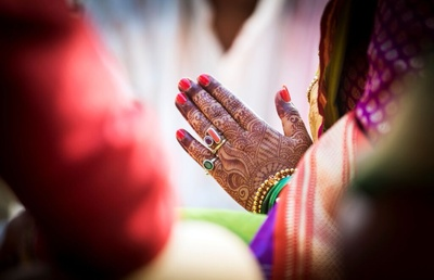 Coral, Emerald and Ruby and a great mehendi design.