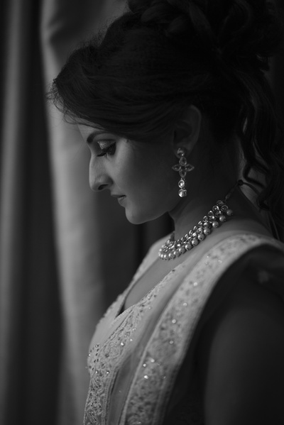 A beautiful side profile of the bride at her sangeet ceremony.