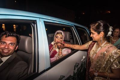 bride in a car for the vidaai ritual