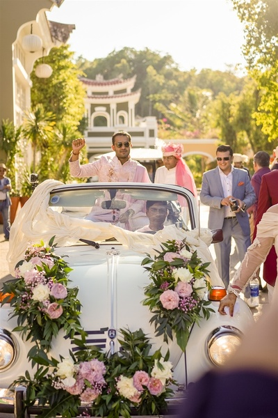 the groom and his squad in a vintage car