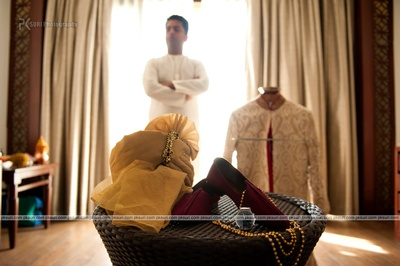 Groom wedding essentials : Maroon mojiris, gold ka;gi embellished safa and watch