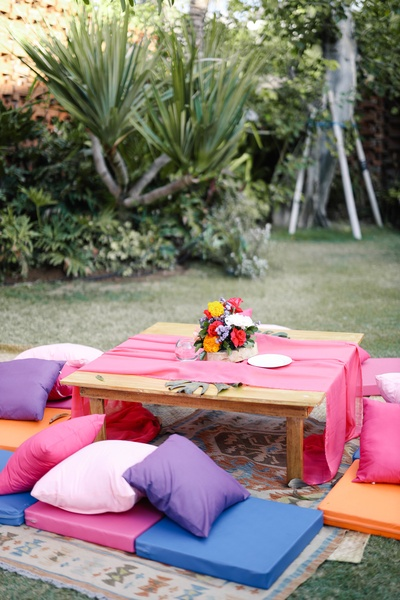 An cozy outdoor seating arrangement for the mehendi ceremony.