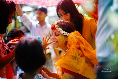 Very beautiful bride wearing yellow saree styled with floral jewellery for her Haldi Ceremony held at Elements, Bangalore.