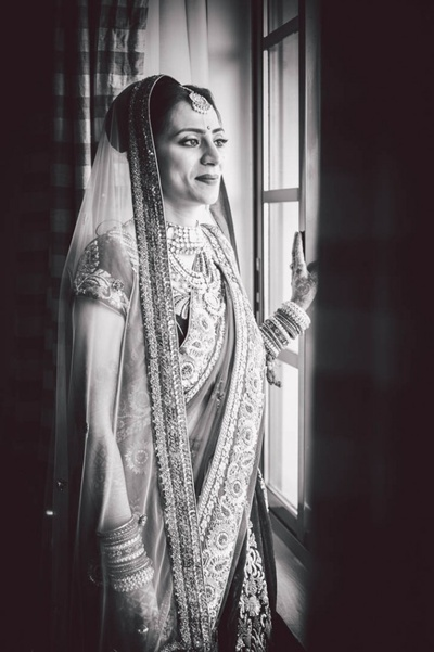 Black and white bridal shot in net pallu and embroidered borders