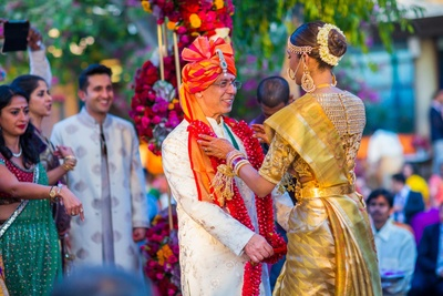 jaimala fun for the bride and groom in their wedding outfits