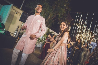a candid picture of the couple dancing at their reception