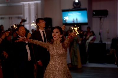 Candid picture of the bride dancing on her reception