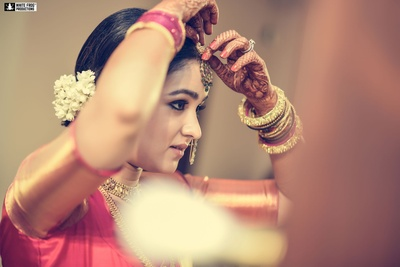 Adorable south-indian bride getting ready for the wedding.