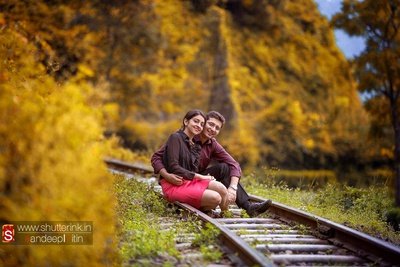 Dressed in formal attires for their pre wedding photo shoot on a train track