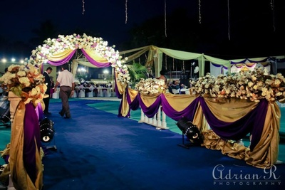 Gold and purple faux flower decor for the reception venue