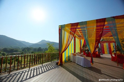 Mutli colored cabanas. Colorful outdoor decor ideas for wedding functions