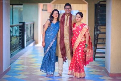 Groom styled in silk kurta churidaar and a dushala