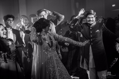 Black and white photo of the bride and groom's sangeet performance