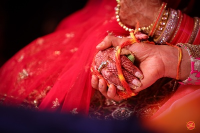 Bride and groom's hand tied together for the wedding ceremony.