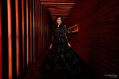 The bride, Saakshi, stuns in a shimmery black gown at her sangeet.