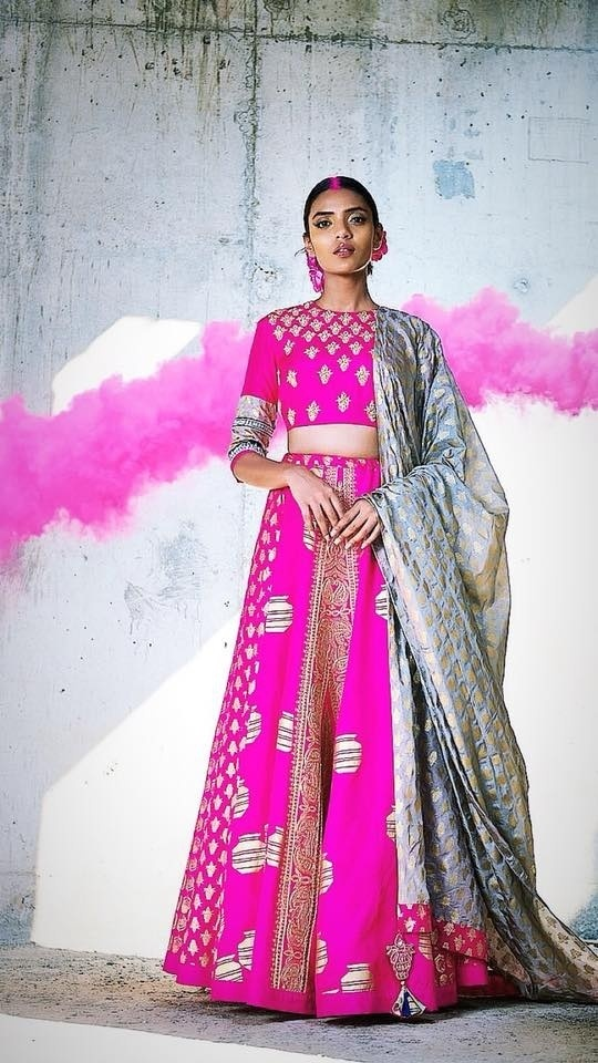 85b01882c8 This knock out pink lehenga-choli with a touch of bluish-grey lehenga colour  combination is pure love. Seriously digging those grey and yellow latkans  on ...