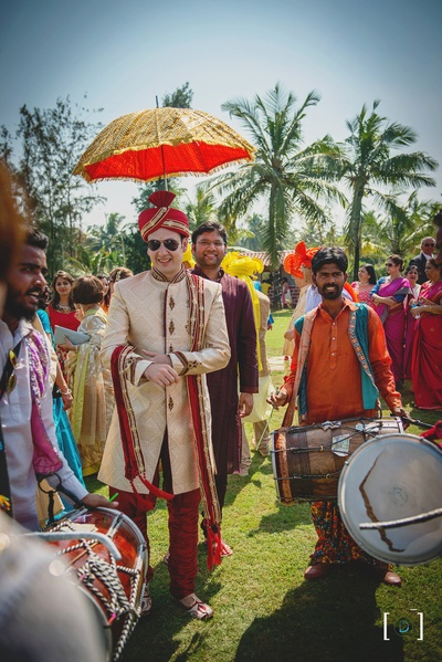 Groom entry amidst colorful baraat and celebration
