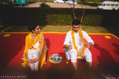 bride and groom at their haldi ceremony at pratap niwas palace, jodhpur