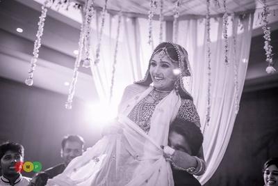 Vedi mandap decorated drapes and Jasmine strings