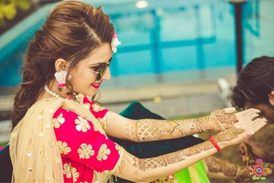 Bride displays her indian wedding mehendi designs for hands